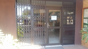 A Bronze double hinge door with Mid rail at Roodepoort College