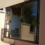 Patio enclosed with bronze aluminium sliding door.