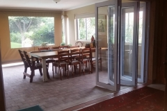 Very open space offered with white stacking folding door