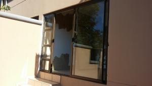 Patio enclosed with bronze aluminium sliding door.