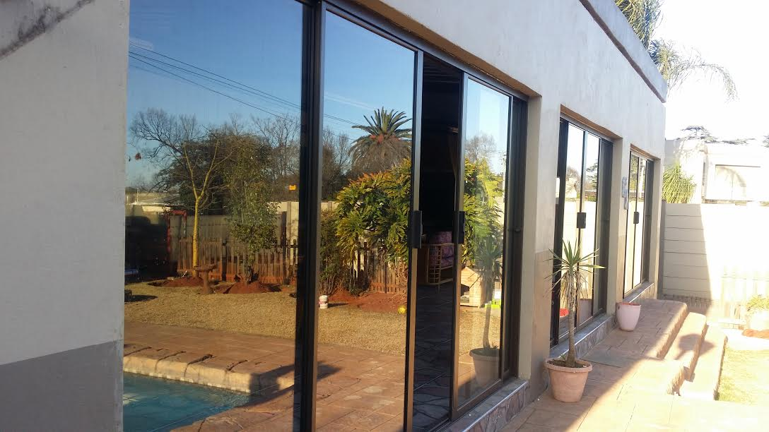 Looking to Enclose a Thatch, Veranda or Entertainment area in 2020 ? – Aluminium Sliding doors are elegant and  affordable.