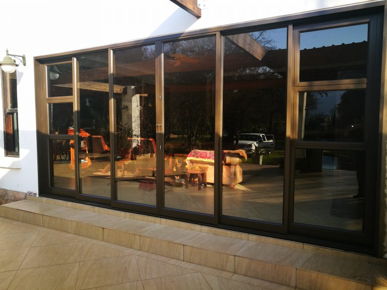 Windorpro supply and fit of Heavy Duty Sliding door with two sidelights and top hung window openers